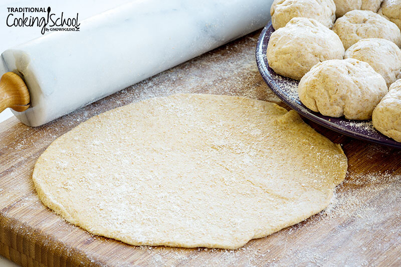 whole wheat flour tortilla rolled out with rolling pin