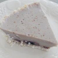 slice of banana pudding pie on white plate
