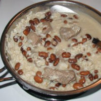 creamy beef and beans with rice in a cast iron pan