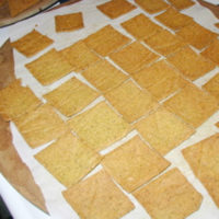 cheesy crackers on parchment paper