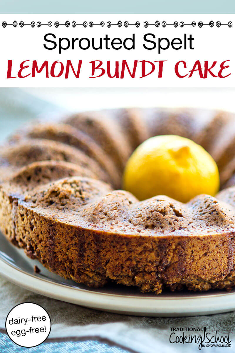 sprouted spelt lemon bundt cake with a fresh lemon in the middle on a white plate