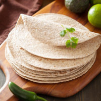 How To Make Sourdough Tortillas {with whole wheat flour!} | Oh, yumm... These sourdough tortillas with whole wheat flour were awesome! Chewy, soft, and pliable! The second day, I heated them up in a warm skillet, one by one, where they retained all their first day softness. | TraditionalCookingSchool.com
