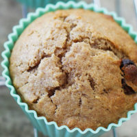 close up shot of a beautiful golden brown muffin in a bright blue silicone muffin cup
