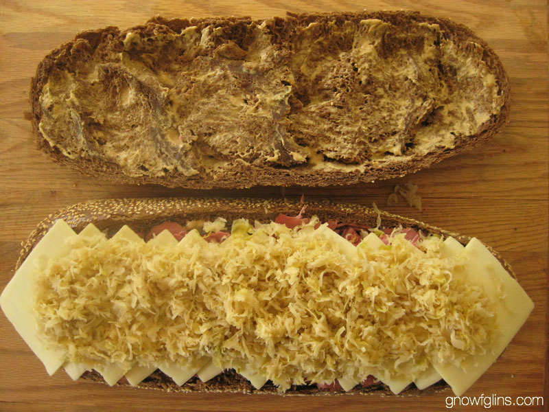 The Big Flat Real Food Reuben Sandwich | Who knew that making a big honkin' loaf-sized sandwich and flattening it under cement blocks, rocks, or gym weights could be so fun (or so delicious)? I'd seen other Big Flat Sandwiches around the internet, but when Wardee first presented the idea of making a real food Big Flat Sandwich, I immediately knew I needed to try my all-time favorite sandwich -- the Reuben. | TraditionalCookingSchool.com