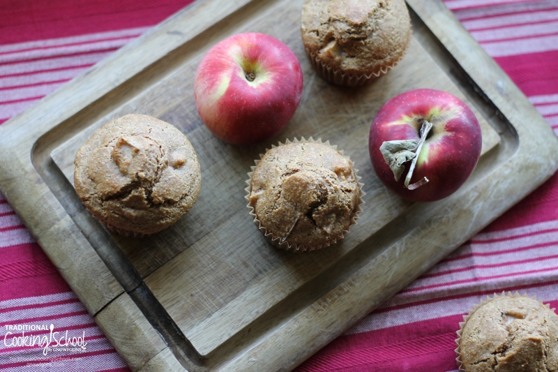 Soaked Apple Cinnamon Muffins | As fall settles in, apples start ripening on the trees, begging to be picked and made into all sorts of delights! One of my favorites is soaked apple cinnamon muffins. Easy to make and yummy, they are wonderful straight out of the oven with butter spread on top. They also make a great breakfast with eggs or a gift to the neighbors. | TraditionalCookingSchool.com