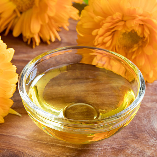 Make Your Own Calendula Salve | Calendula is a wonderful healing herb -- excellent for all skin ailments, quickly healing rashes and wounds, and gentle for the whole family. Make up a batch of this salve in 15 minutes and have a go-to remedy for all rashes, cuts, scrapes, bruises, burns, bites, blisters, and dry skin. Pour it into a pretty jar, top it with a label and ribbon, and it makes a thoughtful gift! | TraditionalCookingSchool.com