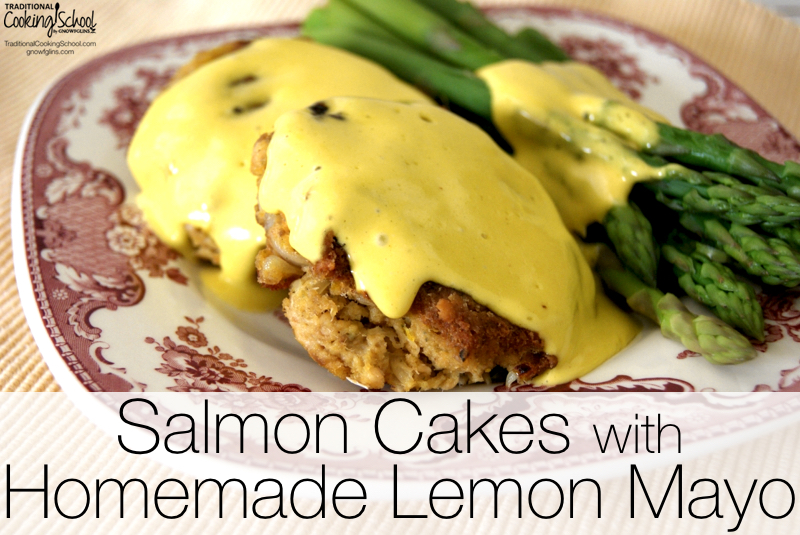 Salmon Cakes with Homemade Lemon Mayo | These salmon cakes are one of my go-to meals when I have nothing planned and need to get something on the table in a hurry. With the mayonnaise made from pastured eggs, and a side of asparagus, they come together quickly while providing us with a healthy meal. | TraditionalCookingSchool.com