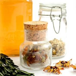 Easy Homemade Herbal Hair Rinses for Beautiful, Healthy, Hair | Drugstore shelves are full of products that promise to give us healthy, manageable, shiny, smooth, strong, and beautiful hair. The problem is, most of those bottles are filled with anything-but-healthy chemicals. Thankfully, we need look no further than our own kitchens, gardens, or local herb shops to find natural, organic care for truly healthy locks! | TraditionalCookingSchool.com