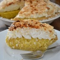 My husband's absolute favorite dessert is... coconut cream pie. For his birthday, I considered overnighting his favorite from Tina's in New Mexico. I snapped back to reality and made one instead. THIS coconut cream pie has nothing to hide -- no white flour, refined sugar, boxed pudding, or margarine.