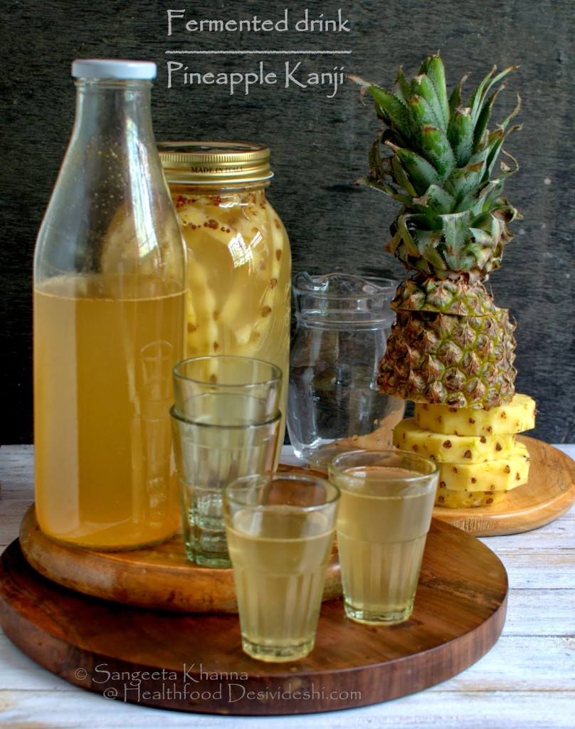 jars and glasses of pineapple kanji alongside a sliced whole pineapple