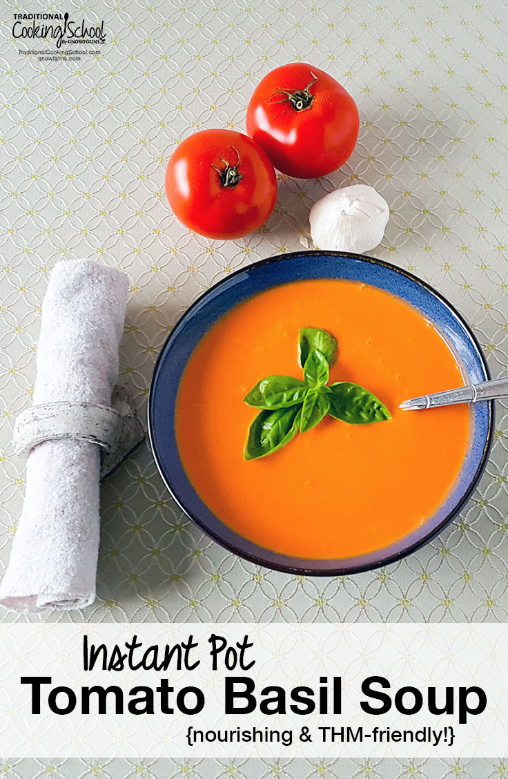 tomato soup in a blue bowl with fresh basil on top and text overlay