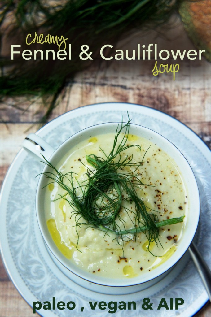 cauliflower soup with fennel garnish in a light blue bowl and plate set
