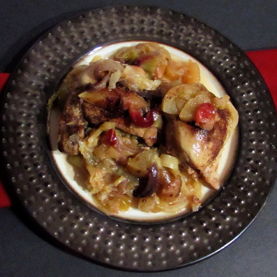 metallic bowl of cranberry apple chicken with cabbage