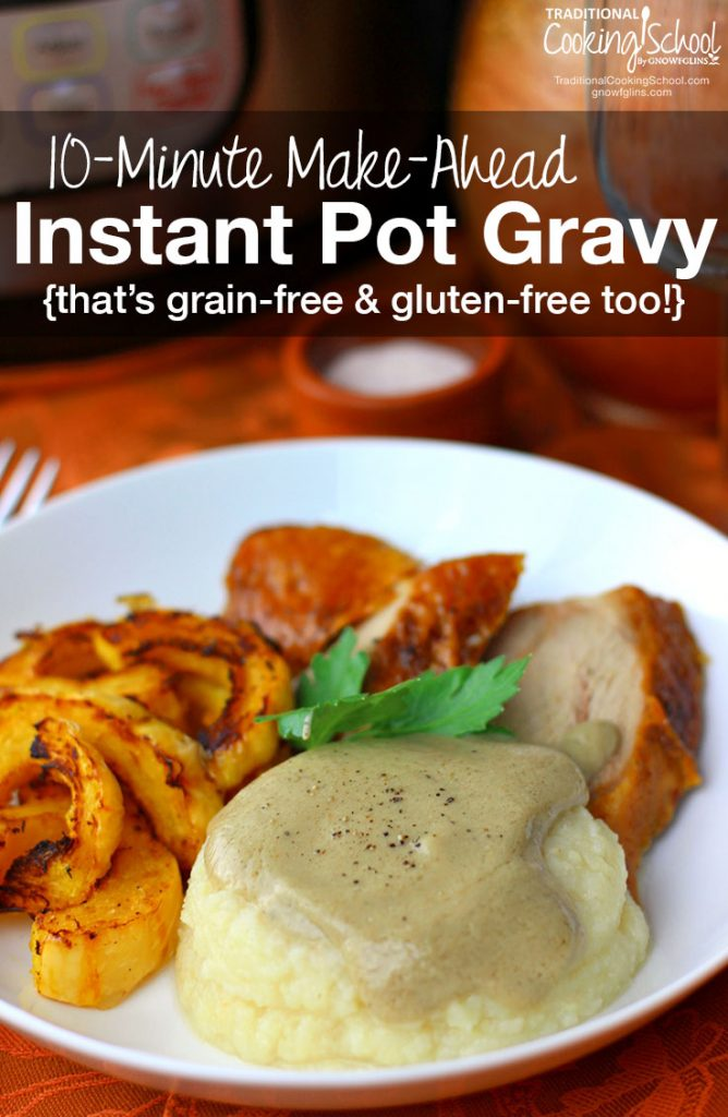 dollop of mashed potatoes slathered in gravy with turkey and sweet potato fries in the background