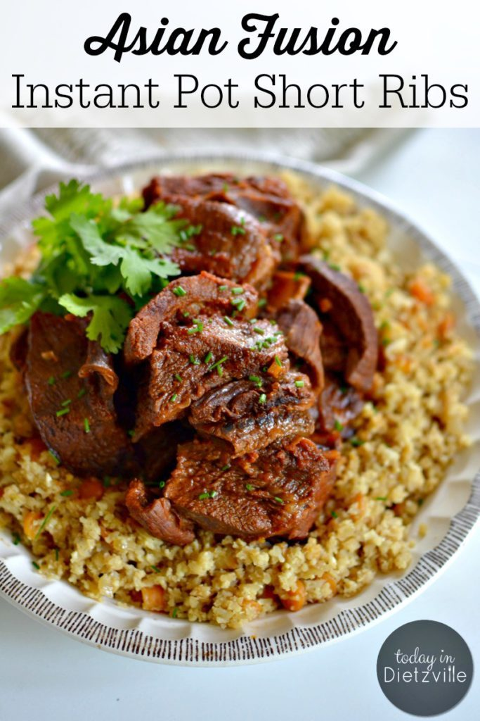 big plate of short ribs on top of quinoa with a parsley garnish
