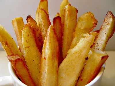 mug of crispy potato fries sticking out