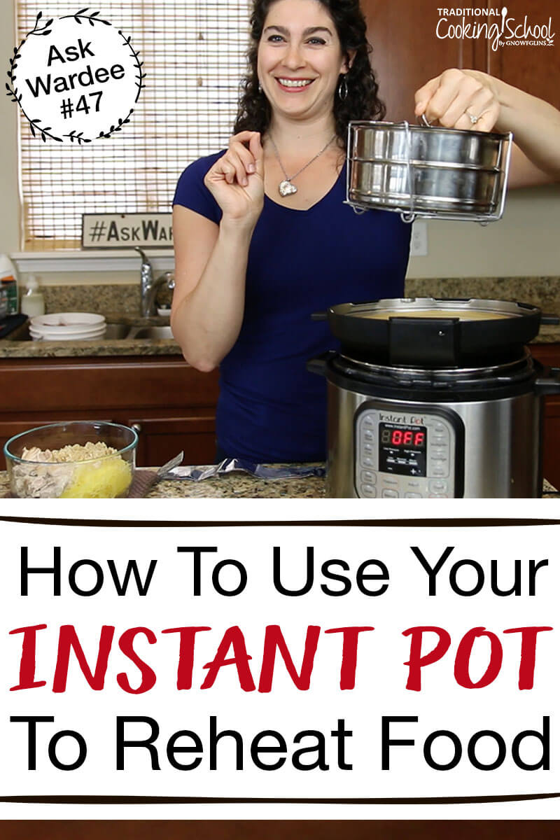 woman in kitchen holding up stacking pans above instant pot
