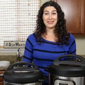 woman with two instant pots in her kitchen
