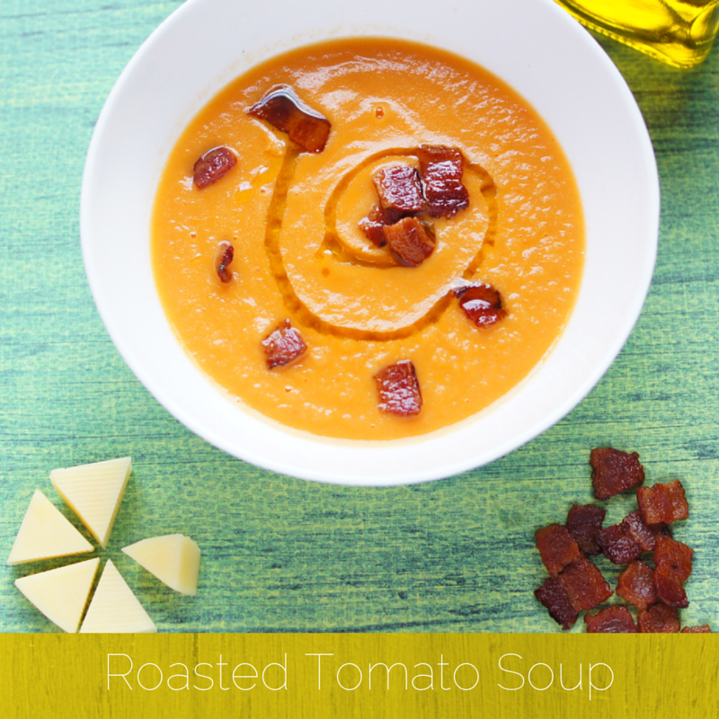 bright orange soup with a drizzle of oil and crispy bacon pieces for garnish