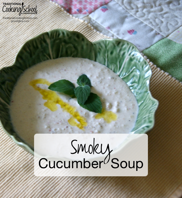 white soup with mint and a drizzle of oil for garnish in a green dish shaped like a bowl made out of leaves