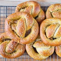 stack of braided sourdough pretzels sprinkled with sesame seeds