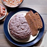 Made from the whole grains that were prevalent in colonial times, Boston brown bread is a New England staple that's sadly fading from American tradition. This version is leavened with sourdough starter and steamed in the Instant Pot!