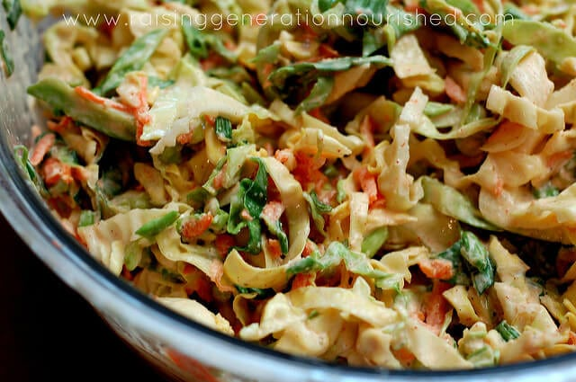 Closeup of coleslaw in glass bowl