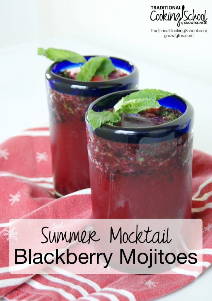 Blackberry mojitoes in blue-rimmed glassware with spearmint and red napkin with black text overlay