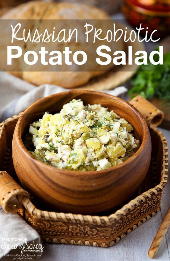 Probiotic potato salad in wooden bowl with white text overlay