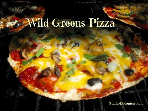 Wild greens pizza with cheese, mushrooms, tomato sauce in the oven with white text overlay