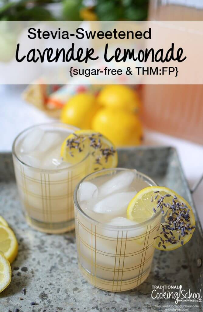 Lavender Lemonade with ice and lemons on stone tray with black text overlay