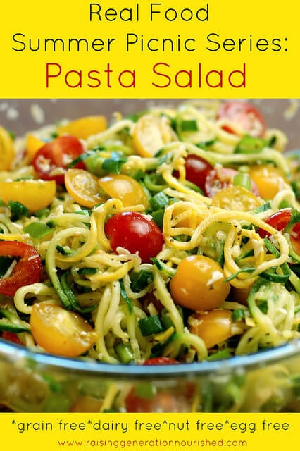 Pasta salad with zucchini and tomatoes in glass bowl with yellow border and text overlay
