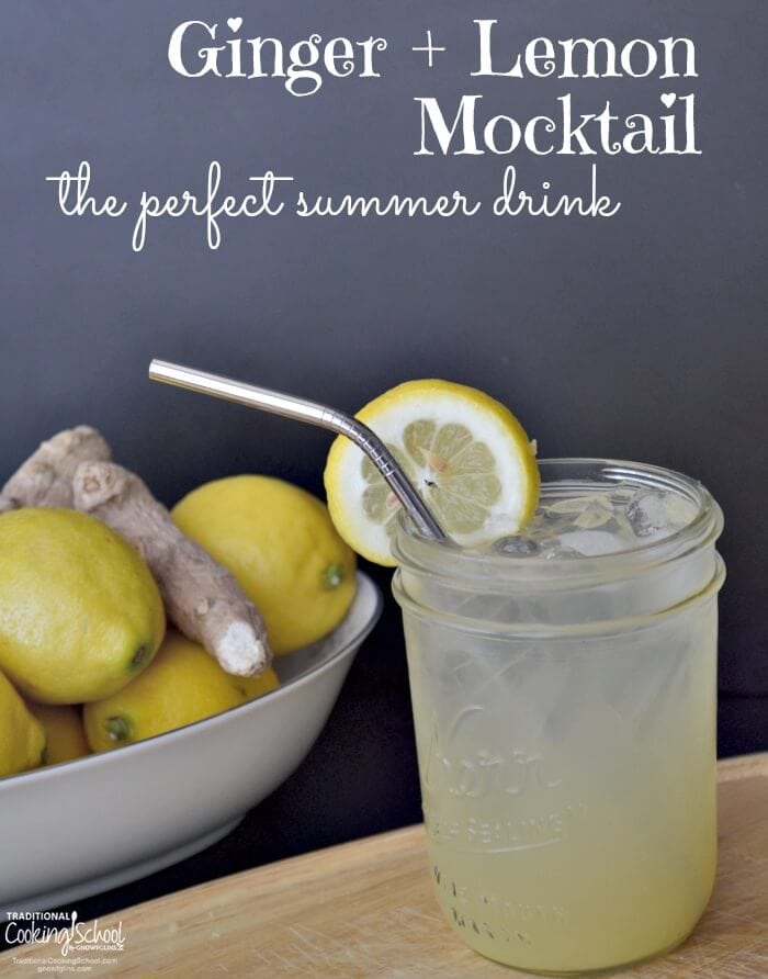 Mocktail in glass with straw with ginger and lemon in white bowl with white text overlay