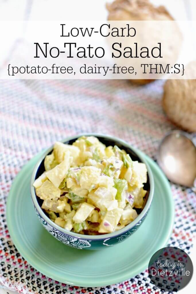bowl of potato salad sitting on mint green plate