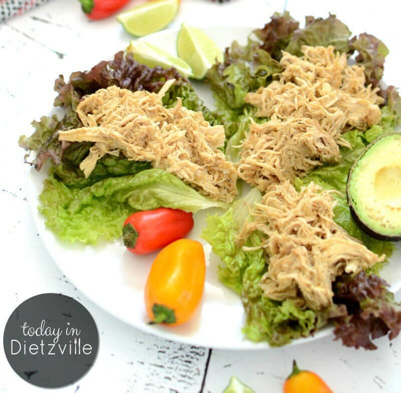 shredded chicken on lettuce leaves with peppers