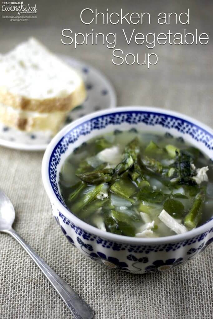 bowls of soup with chicken and green leaves