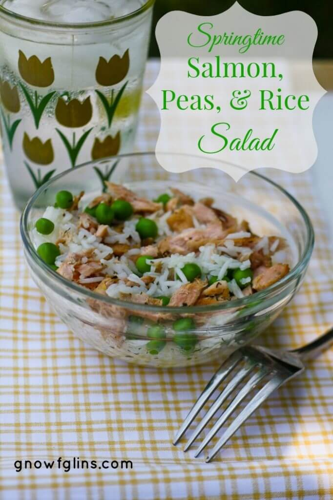 salmon salad with peas and rice in clear bowl