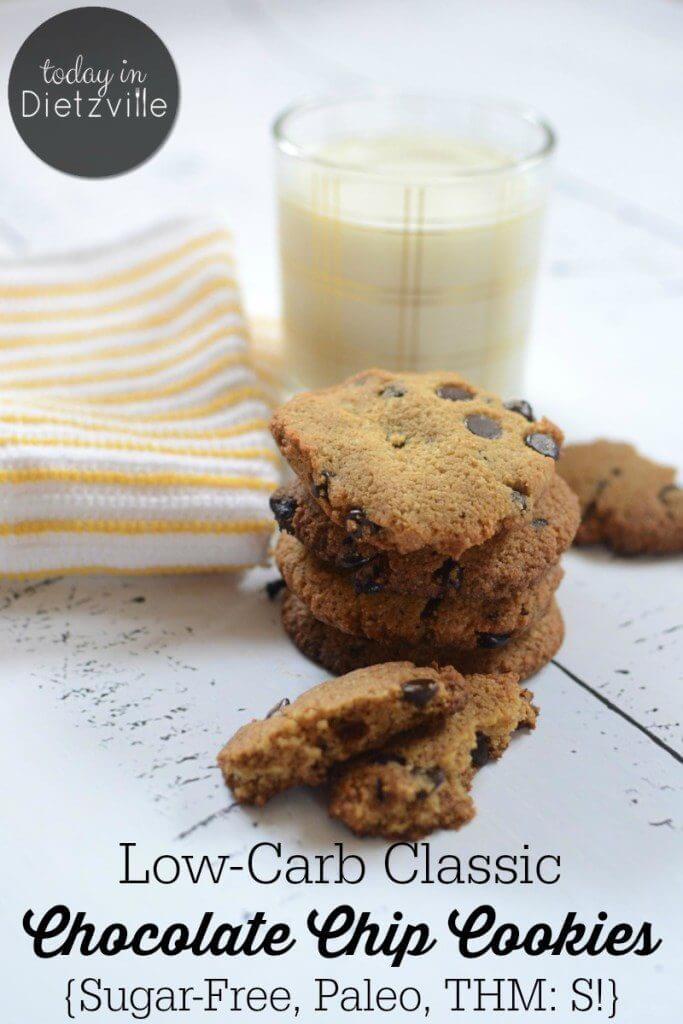 chocolate chip cookies stacked in front of glass of milk