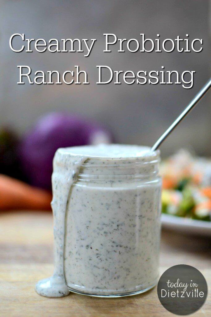 jar of homemade ranch dressing with dressing spilling over the rim of the jar