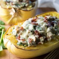 Have you tried stuffing your favorite winter squash yet? Squashes act as the perfect low-carb vessel to transport amazing flavors right into your mouth! This Grain-Free Chicken, Bacon, and Ranch Stuffed Spaghetti Squash is hearty and zesty -- perfect for satisfying comfort food cravings in a healthy, nourishing, veggie-filled way!