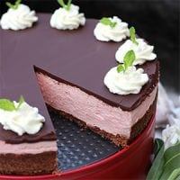 Are you looking for the best winter holiday cheesecake recipe? This is it! This No-Bake Peppermint Cheesecake is light, yet rich and satisfying, with a chocolate ganache topping. It's egg-free, grain-free, gluten-free, refined sugar-free, and has a low-carb option -- perfect for anyone, as long as you can have dairy!