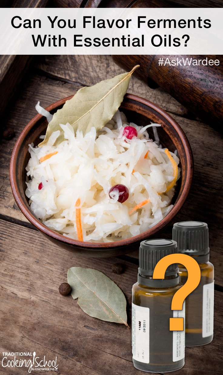 bowl of sauerkraut with bay leaves and essential oil bottles