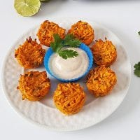 Is there any way to make tater tots good for you? With these grain-free Garlic-Lime Mini Sweet Potato Puffs, the answer is YES! These make an easy and nourishing appetizer, side dish, or snack, and the chili-yogurt dipping sauce is a delicious way to get extra probiotics into your meal.