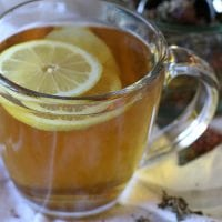 clear mug of tea with lemon