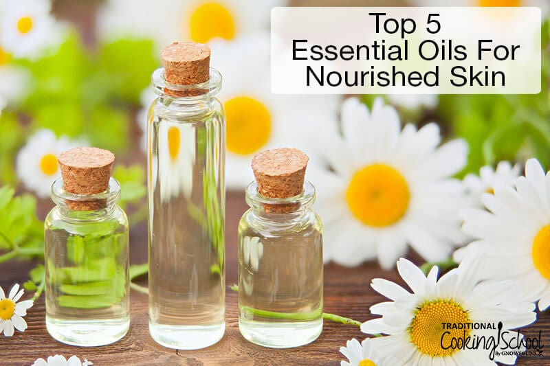 glass bottles surrounded by chamomile flowers