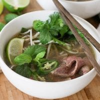 instant pot gaps diet beef pho in white bowl with fresh cilantro