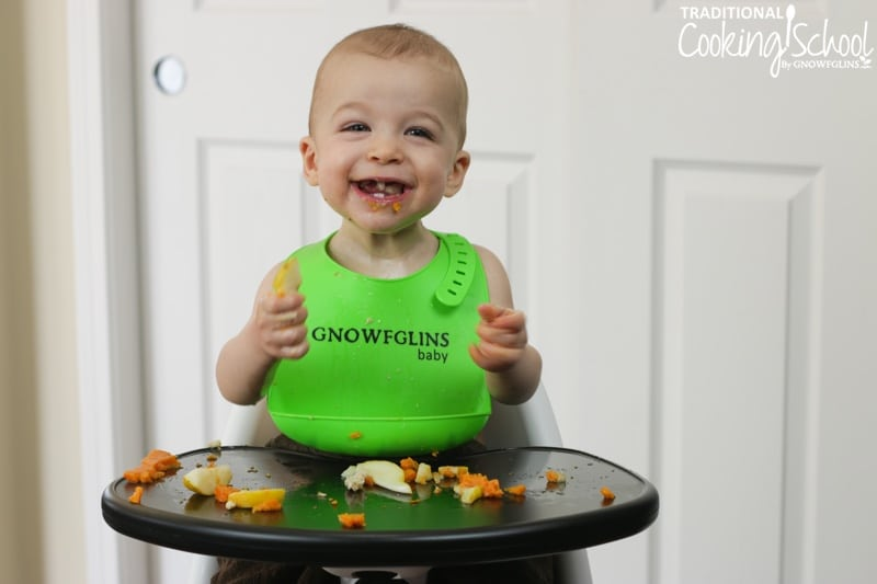 happy gnowfglins baby eating nourishing solid foods