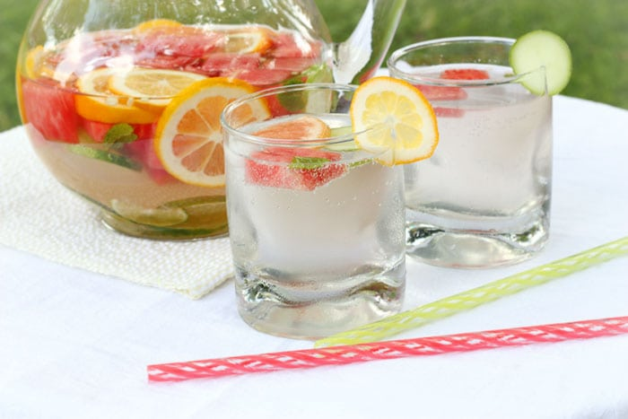 fruit-infused water in pitcher and glasses
