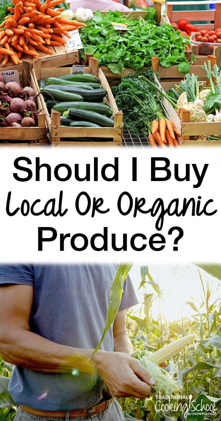 should i buy local or organic produce with crates of fresh farmers market vegetables and farmer holding ear of corn in a field