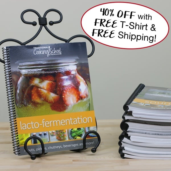 "photo of Traditional Cooking School's Lacto-Fermentation Textbook next to a stack of other textbooks, with text overlay: ""40% OFF with FREE T-Shirt & FREE Shipping!"""